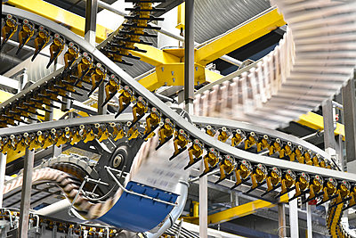 Conveyor belts with newspapers in a printing shop - p300m1068872f by lyzs