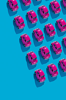 Pink toy cars on a blue background - p1423m2222542 by JUAN MOYANO