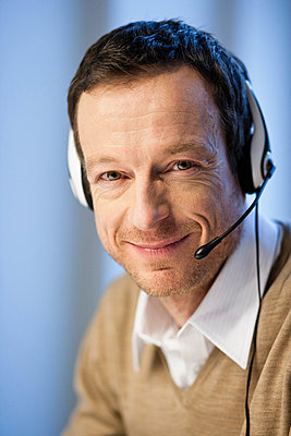 Man with headset - p42910031f by Brigitte Sporrer