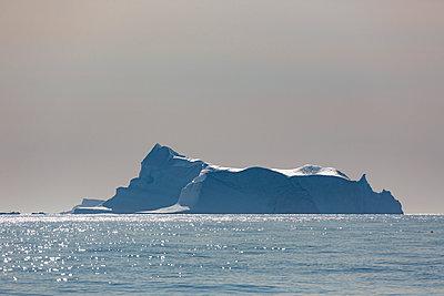 Majestic iceberg formation on sunny Atlantic Ocean Greenland - p1023m2161510 by Martin Barraud