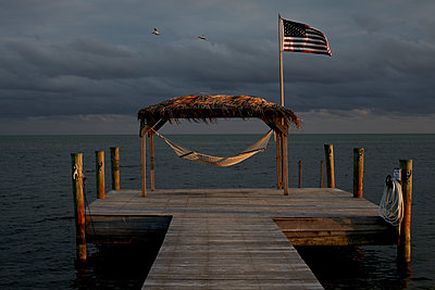 Hammock on dock - p1260m1127697 by Ted Catanzaro