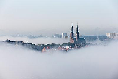 City in fog - p312m1192868 by Henrik Trygg