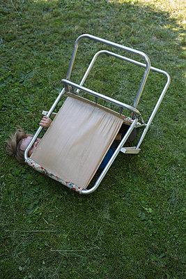 Boy under garden chair - p1308m2126726 by felice douglas