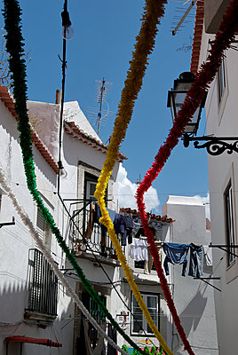 Colourful garlands between dwelling houses - p260m1161243 by Frank Dan Hofacker