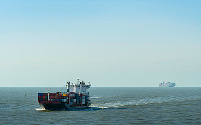 Container ships sailing north sea en route to Rotterdam harbour, Netherlands - p429m1135304f by Mischa Keijser