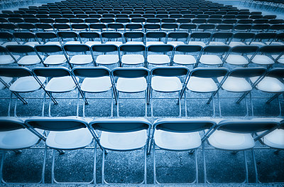 Blue toned black white row chairs grandstand wet - p609m1219853 by OSKARQ