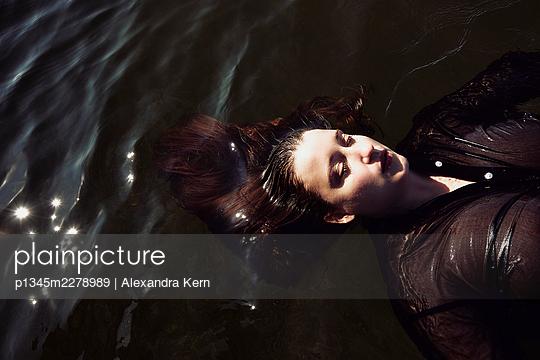 Woman in a lake - p1345m2278989 by Alexandra Kern