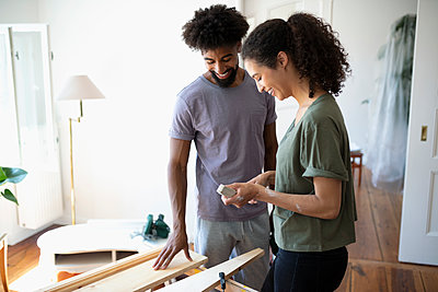 Couple doing DIY carpentry project - p1192m2016689 by Hero Images