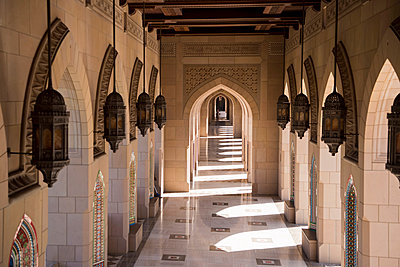 Middle East, Oman, Muscat.  Arched, open-air arcades surround the main building of The Sultan Qaboos Grand Mosque - p652m1576196 by John Warburton-Lee