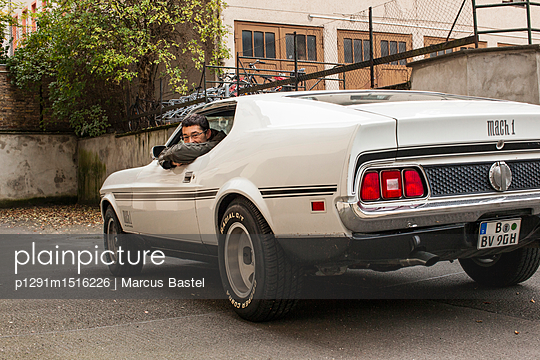 Man in Muscle Car - p1291m1516226 by Marcus Bastel