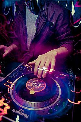 A DJ plays dubstep at Amazon Bar in Hanoi, Vietnam, Asia - p934m832504 by Dominic Blewett