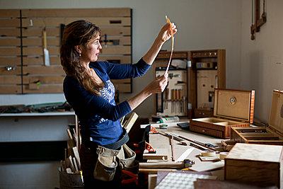 Woman working in workshop - p312m1499153 by Susanne Kronholm