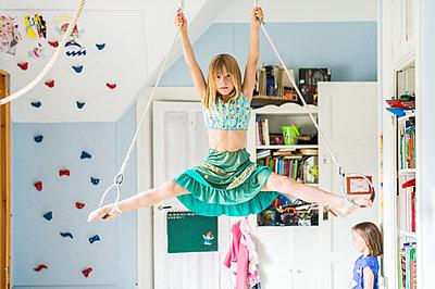 Girl doing splits while hanging - p312m1407615 by Fredrik Schlyter