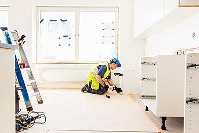 Builder at work - p312m1187750 by Susanne Kronholm