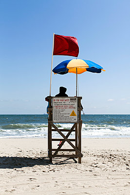 Rear view of a lifeguard on duty on a beach - p1094m890270 by Patrick Strattner