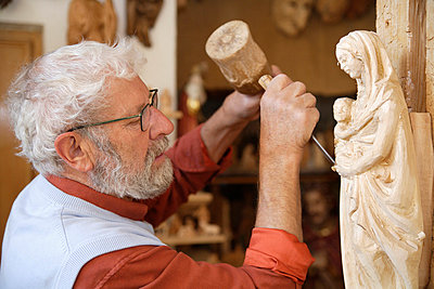 Craftsperson carving statue - p30020392f by Tom Chance