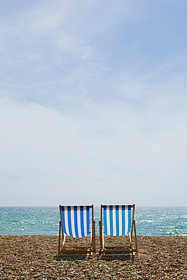 Deckchairs on brighton beach - p9249284f by Image Source
