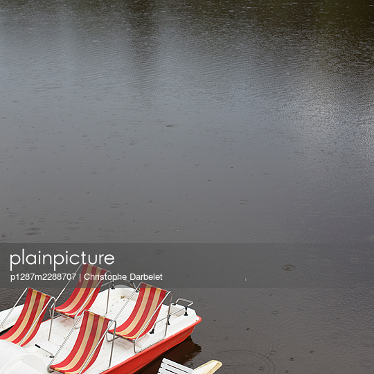 Empty canvas chairs on the waterfront - p1287m2288707 by Christophe Darbelet