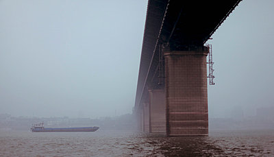 Low angle view of bridge over river against clear sky, Wuhan, China - p301m1029432f by Gregor Sawatzki