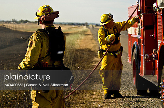 Firemen By The Side Of A Country Road