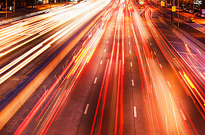 Car lights on freeway - p9247491f by Image Source