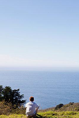 Man watching the sea - p956m1044267 by Anna Quinn