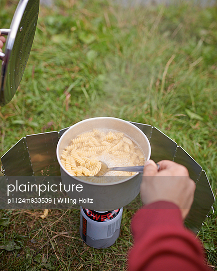 Making pasta with camping cooker