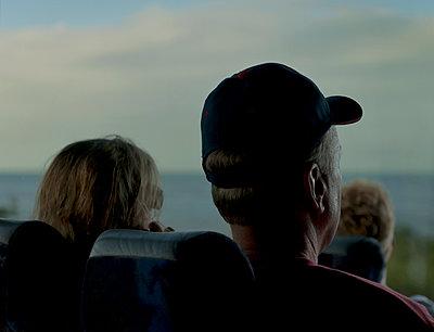 Couple on bus trip - p1125m943652 by jonlove