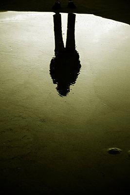 Figure Reflected in Water - p975m1110555 by Hayden Verry