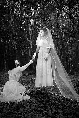 Brides with white masks in the forest - p1521m2214993 by Charlotte Zobel