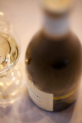 Detail of a bottle of white wine and a wine glass - p301m799762f by Marc Volk