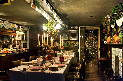Christmas card display above dining table in Cheltenham country home - p349m790924 by Polly Eltes