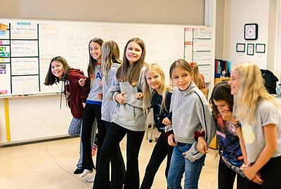Girls in classroom - p312m2174464 by Scandinav