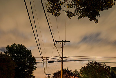 Telephone Poles and Power Lines on a Suburban Street on a Cloudy Night - p5690184 by Jeff Spielman