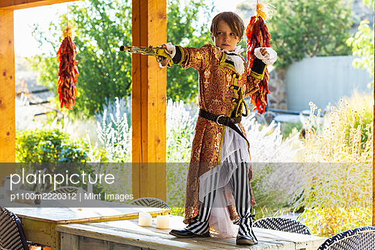 Young boy dressed as a pirate. - p1100m2220312 by Mint Images