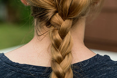 Rear view of woman with plaited red hair - p924m1422772 by Raphye Alexius