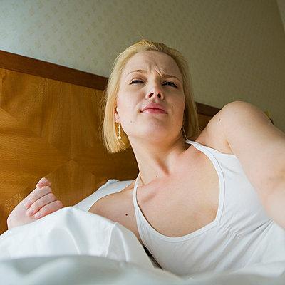Tired girl - p4264882f by Tuomas Marttila