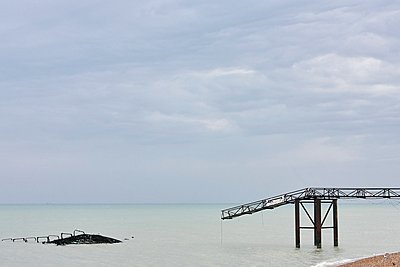 Seascape with remains of old Brighton pier, Brighton, England - p429m1106738f by Gu