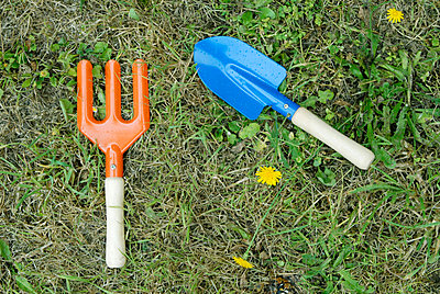 Gardening tools on the lawn - p6810075 by Sandrine Léon