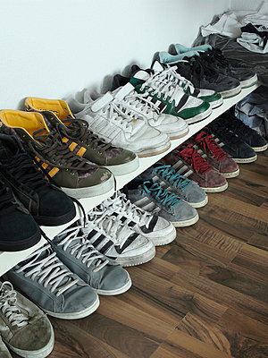 Rows of trainers against a wall - p30113226f by Paul Hudson