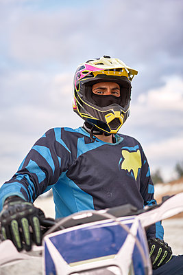 Motorbiker on motocross racing course, portrait - p1630m2206231 by Sergey Mironov