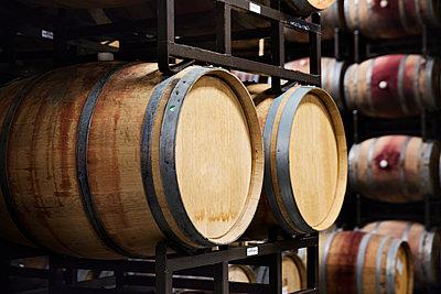 Wooden barrels in wine cellar - p1166m1164332 by Cavan Images