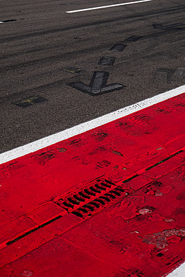 Markings and gully on racetrack - p300m2060040 by Hans Mitterer