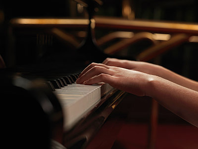 Close up of girls hands playing piano keys - p429m1012931f by Elke Meitzel