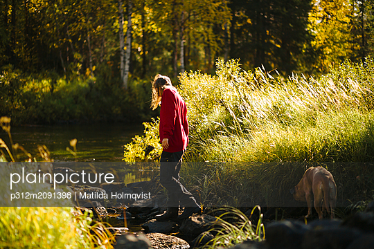 Woman in forest - p312m2091398 by Matilda Holmqvist