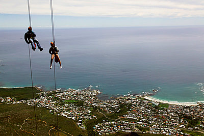 Abseilers descend cliffs on Table Mountain above Cape Town, Cape Peninsula, Western Cape, South Africa, Africa - p871m993833 by David Pickford
