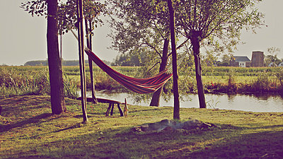 Hammock on the riverbank - p896m835195 by Richard Brocken