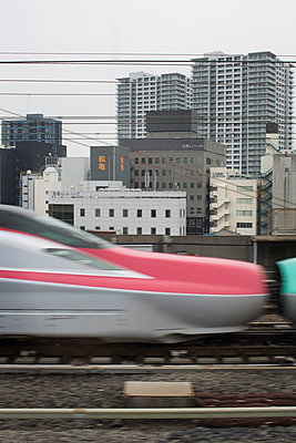 High speed train passing by in Tokyo - p1134m1440625 by Pia Grimbühler