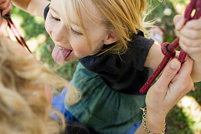 Girl sticking tongue out - p429m1477708 by Christine Schneider