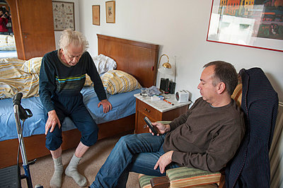Old man in bedroom - p896m836014 by Sabine Joosten